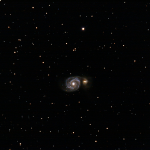 M51, imaged from Roberts Creek on June 8th 2015 with a Megrez 120mm, Canon 60Da, 189 mins total exposures at 1600 ISO. Messier 51 (the Whirlpool galaxy or NGC 5194) is a spiral galaxy in the constellation Canes Venatici, Mag. 8.4. It was the first galaxy to be classified as a spiral galaxy. It was discovered in1773 by Charles Messier. The image includes Messier 51's companion galaxy, NGC 5195. It has been theorized that the two galaxies are connected or colliding, but it is now generally recognized that they are two separate and distinct galaxies. However, it is believed that the prominent spiral structure of Messier 51 is due to its gravitational interaction with NGC 5195.